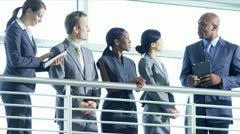 Multi ethnic team meeting on atrium - stock footage