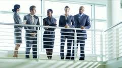 Multi ethnic team meeting on atrium Stock Footage