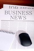 Business newspaper, notebook and mouse Stock Photos
