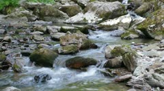 Beautiful mountain river flowing down through the rocks. - stock footage