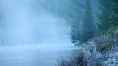 Foggy river in mountain forest. - stock footage