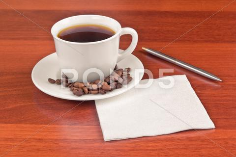 Stock photo of cup of coffee and napkin