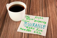 insurance on a napkin - stock photo
