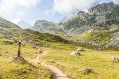 path sign on italian alps - stock photo