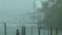 Rising storm surge floods waterfront homes Stock Footage