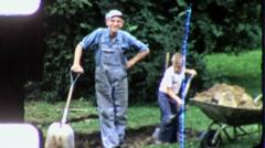 DIGGING GARDEN Grandfather Grandson 1960 (Vintage Old Film Home Movie) 5759 Stock Footage