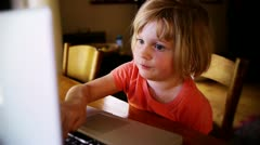 Girl tying on computer Stock Footage