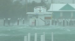 hurricane whipped wind and waves batter a dock and marina - stock footage