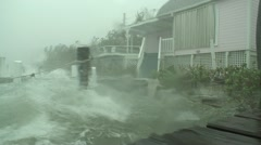 Wind and waves batter a waterfront home Stock Footage