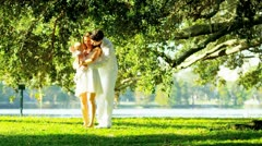 Young Caucasian Parents Baby Girl Outdoors Park Stock Footage