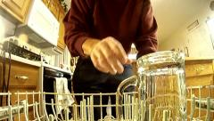 Removing glass from dishwasher - from inside dish washer view Stock Footage