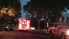 Ambulance Driving Away with Lights On Stock Footage