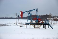 Oil production in the winter. Oil pumps Stock Photos