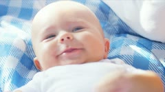 Close Up Head Shoulders Smiling Caucasian Baby - stock footage