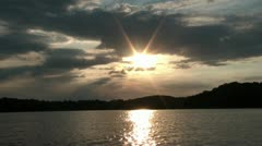 Bobbing Boat Sunset on Lake View Stock Footage