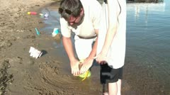 Father and Son Make a Sandcastle at Lake Stock Footage