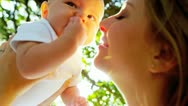 Close Up Happy Baby Held High Young Mother Stock Footage