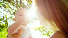 Caucasian Mother Outdoors Baby Son Stock Footage