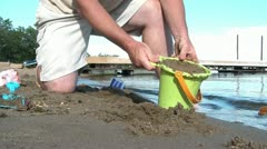 Boy and Father Make Sandcastle at Beach Stock Footage