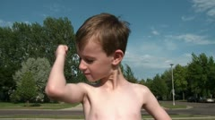 Boy Kisses Muscles in Sunlight Stock Footage