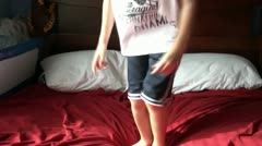 Boy Jumping on Bed Stock Footage