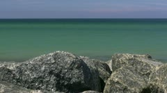 Boulders on the Beach in front of Turquoise Water - Baltic Sea, Northern Germany Stock Footage