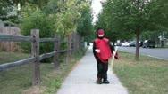 Boy Swinging Stick in Ninja Costume Stock Footage
