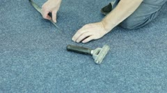 Worker spreading carpet Stock Footage