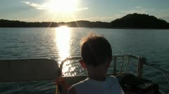 Boys Boat Ride Towards Sunset Stock Footage