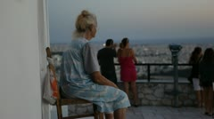 Athens city views - old woman on Likavitos hill - stock footage