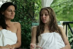 Two women chatting together in spa resort, steadicam shot - stock footage