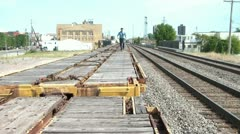 Business Guy Jumping Over Train Cars Stock Footage