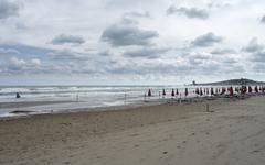 deserted beach and cloudy sky - stock photo