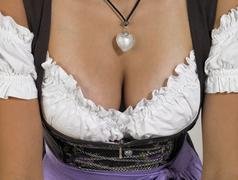 Cleavage in a dirndl Stock Photos