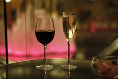 Wine and champagne, pink background Stock Photos