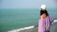 Attractive woman looking at the sea Stock Footage