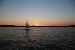 Sailboat Against a Sunset - stock photo