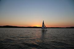 Sailboat Against a Sunset Stock Photos
