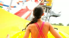 Young Girl Fun Riding Water Slide Stock Footage