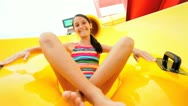 Young Girl Fun Riding Water Slide Inflatable Stock Footage