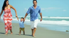 Hispanic family spending vacation on beach playing soccer  - stock footage