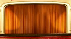 Theater curtains opening orange Stock Footage