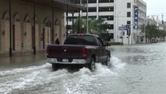 Truck drives through flooded street Stock Footage