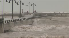 Hurricane waves storm surge pier - stock footage