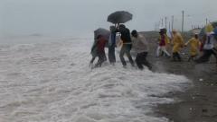 Hurricane storm surge waves hit people Stock Footage