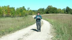 Businessman Lost on Dirt Road Using Map Stock Footage