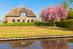 Traditional dutch house at spring Stock Photos