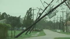 Hurricane damage downed power poles wires - stock footage