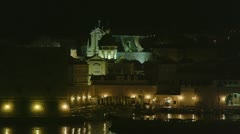 Entrance to the Dubrovnik old town harbor by night Stock Footage
