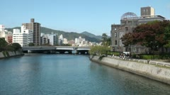 Atomic Bomb Dome across the river from the Peace Memorial Park in Hiroshima - stock footage